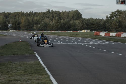 People Riding on Go Kart on Road