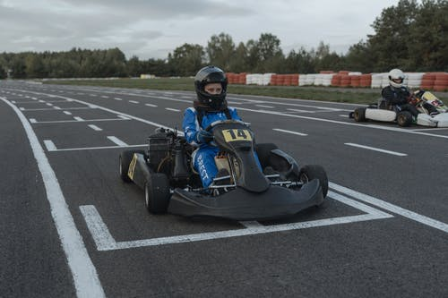 Person Riding on Go Kart