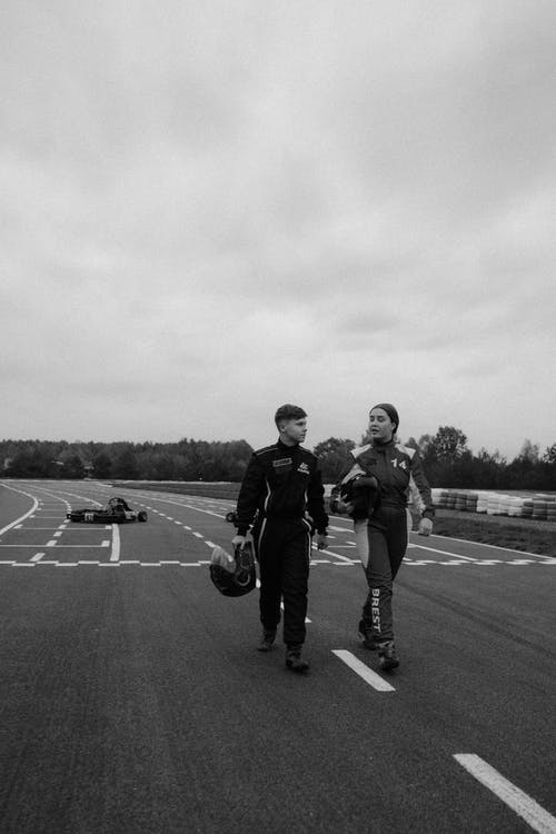 Grayscale Photo of 2 Men Walking on Road