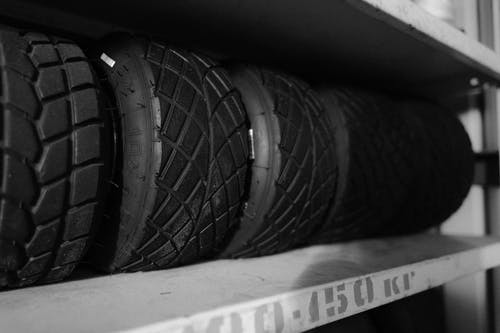 Grayscale Photo of Car Tire