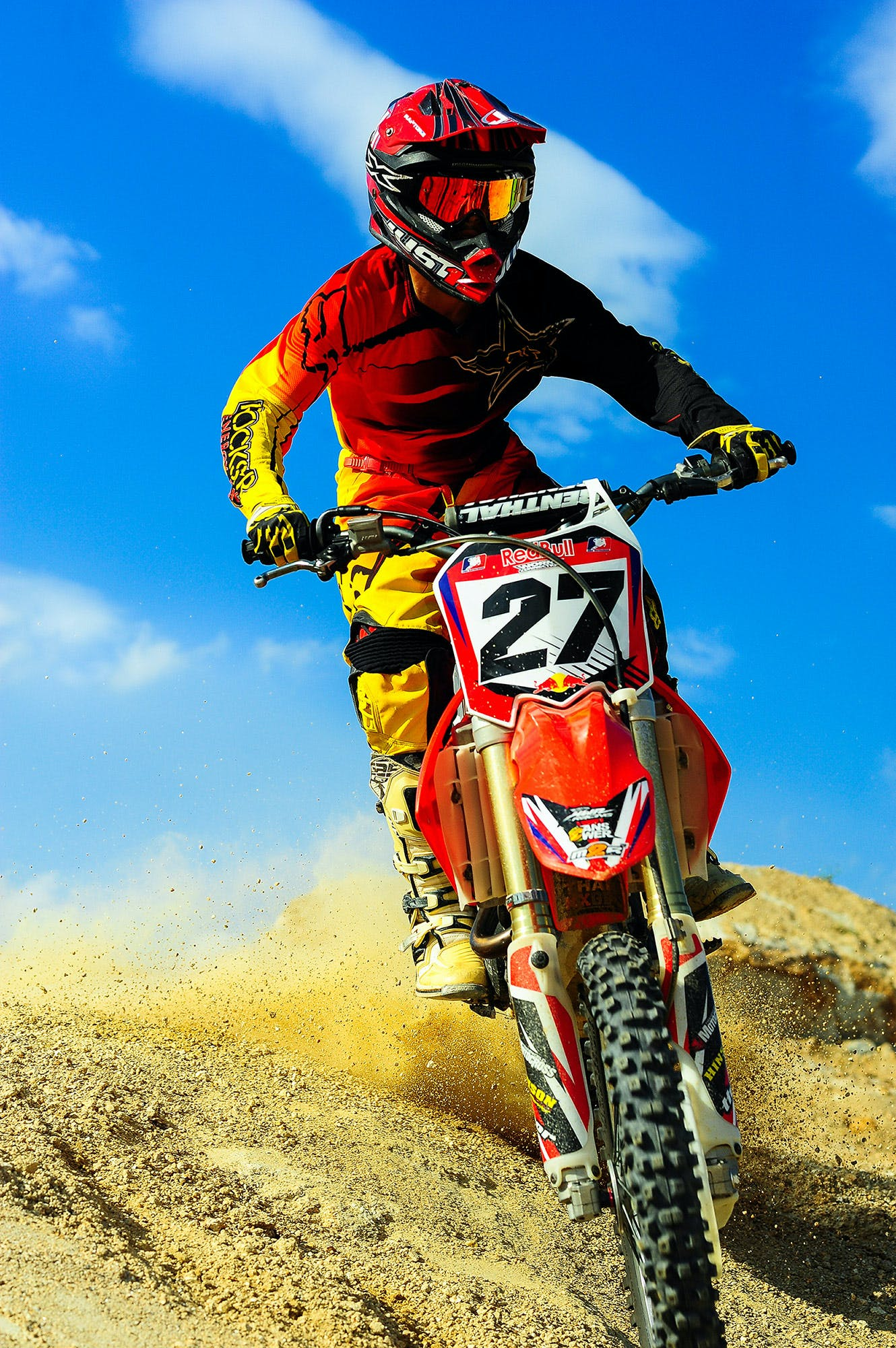Photo of Person Riding Motocross Dirt Bike