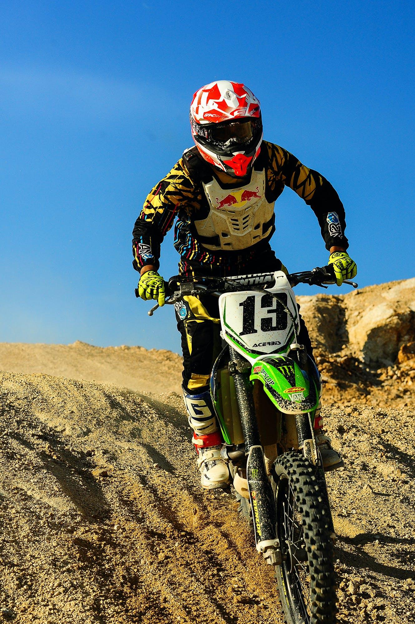 Man Riding Motocross Dirt Bike on Hill