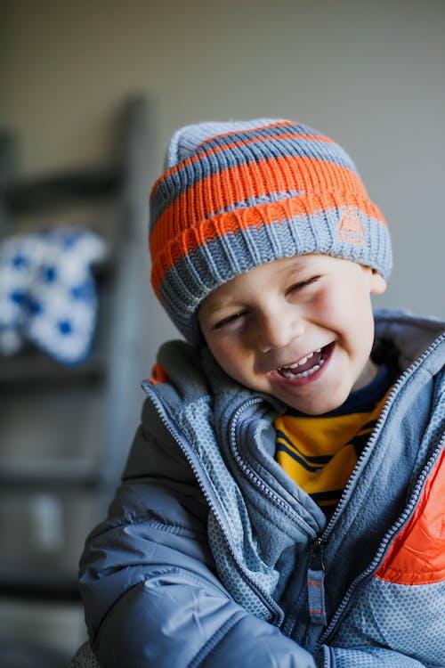Cute boy in warm clothes