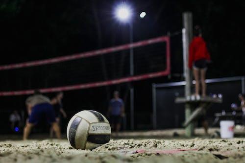 Volleyball on sandy sports ground