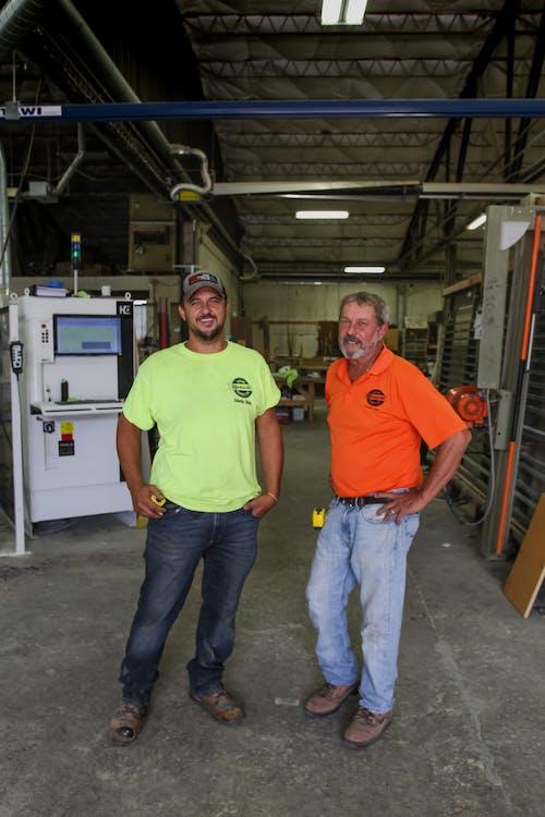 Workers of modern carpentry workshop