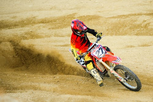 Person Riding Number 27 Motocross Dirt Bike