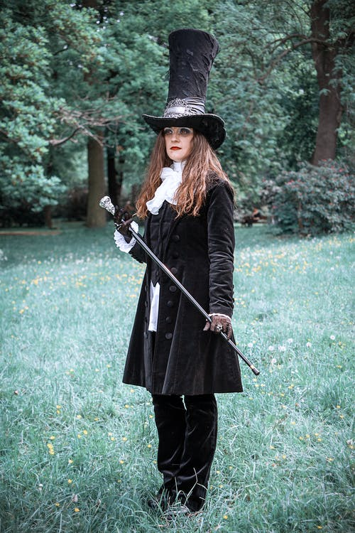 Woman in Black Coat Holding Black and Gray Rifle
