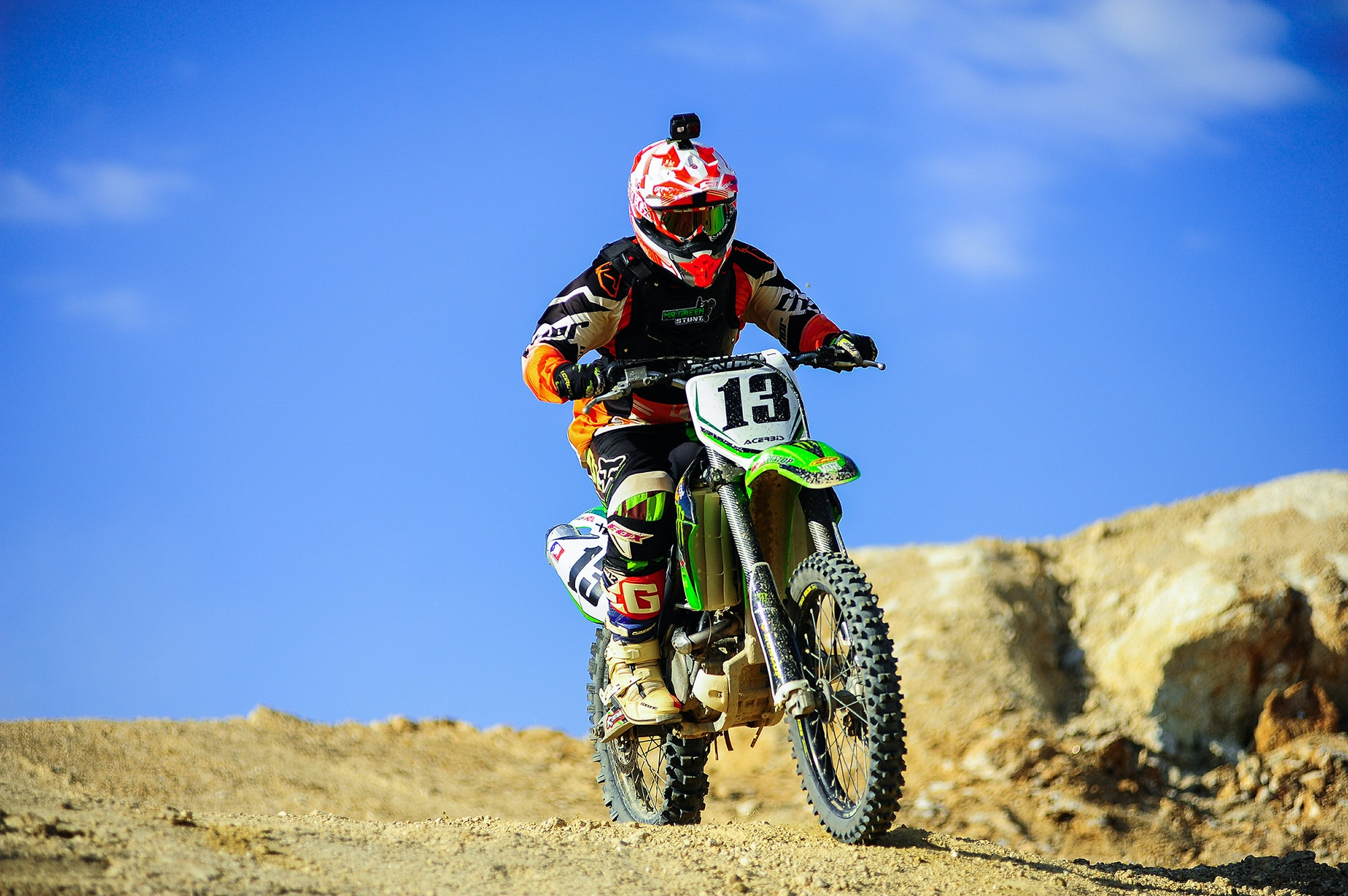 Man in White and Orange Motocross Overall Riding His Motocross Dirt Bike during Daytime · Free ...