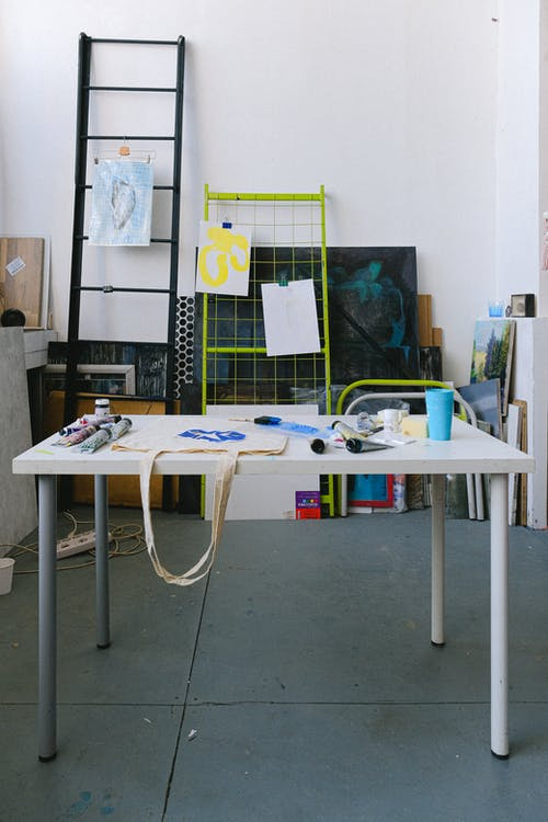 Table with art supplies in studio