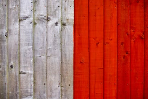 Background of old wooden planks painted with white and bright red colors