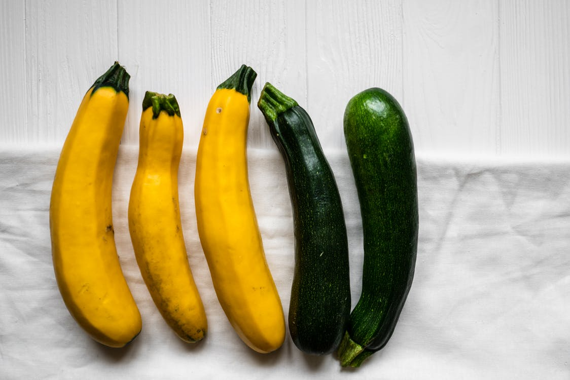 Yellow and Green Vegetable on White Wooden Table