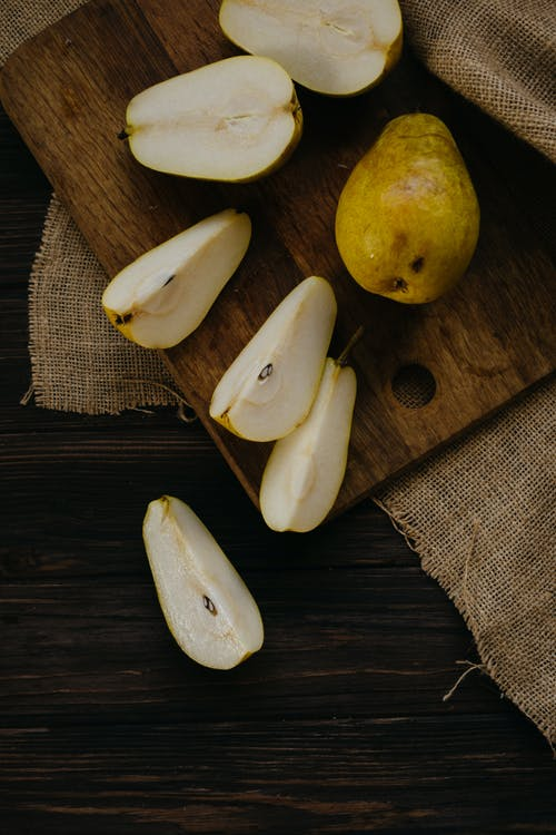 Yellow Pear Fruit on Brown Wooden Table