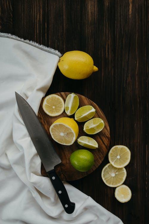Sliced Lemon Beside Sliced Lemon on White Textile