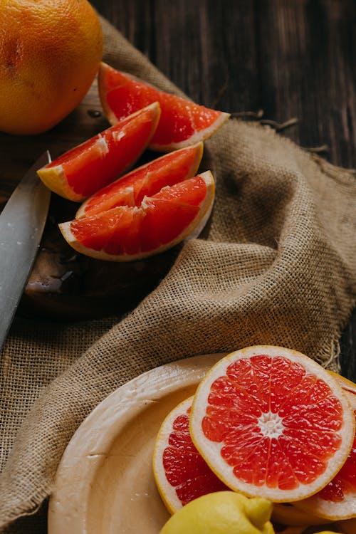 Sliced Orange Fruit on Brown Round Plate