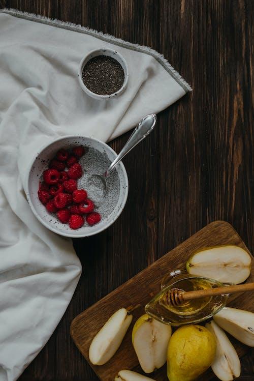Chia yogurt with raspberry and pears