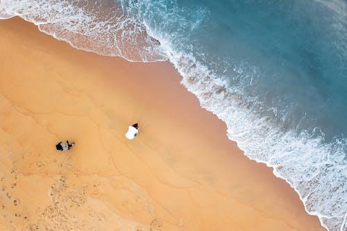 People resting on ocean beach