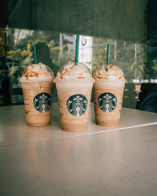 Set of delicious iced coffees with whipped cream to go