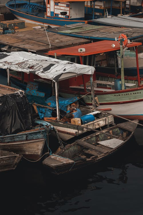 Old small wooden fishing boats on river side