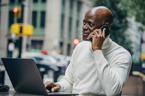 Black businessman talking on mobile phone