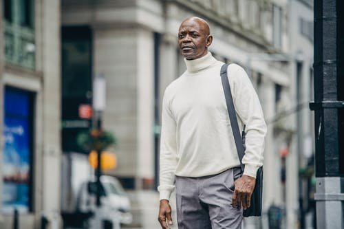 Serious black man on city street