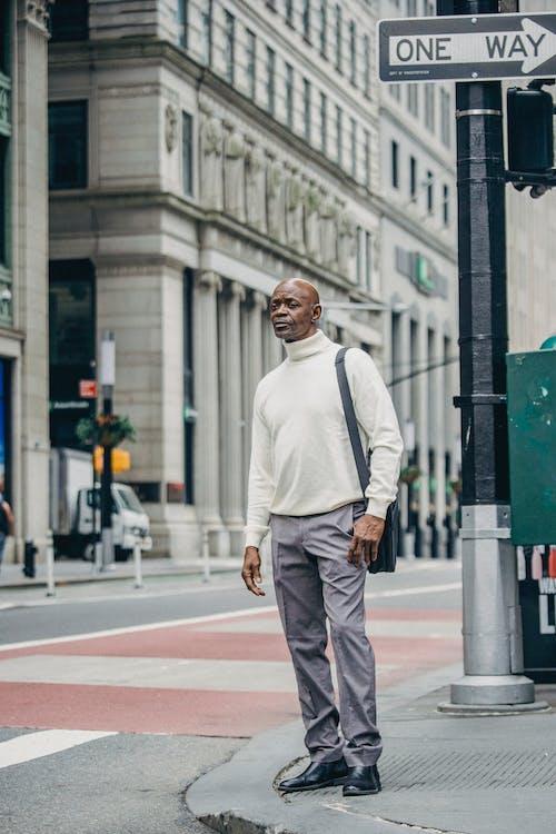 Stylish businessman on street in downtown