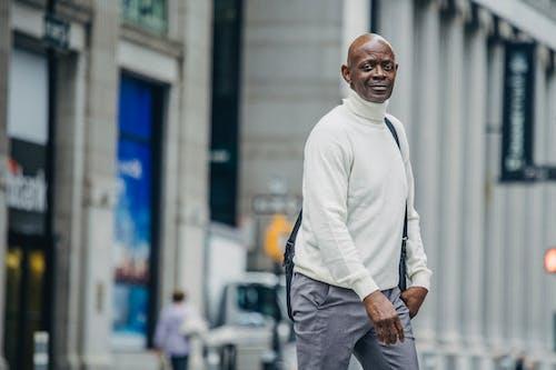 Black man crossing road in downtown