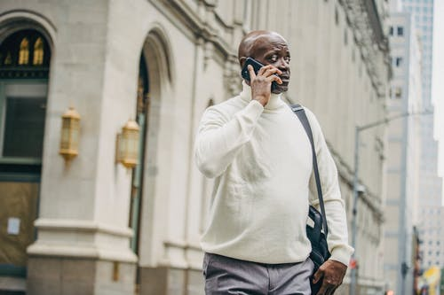 Black businessman speaking on mobile phone