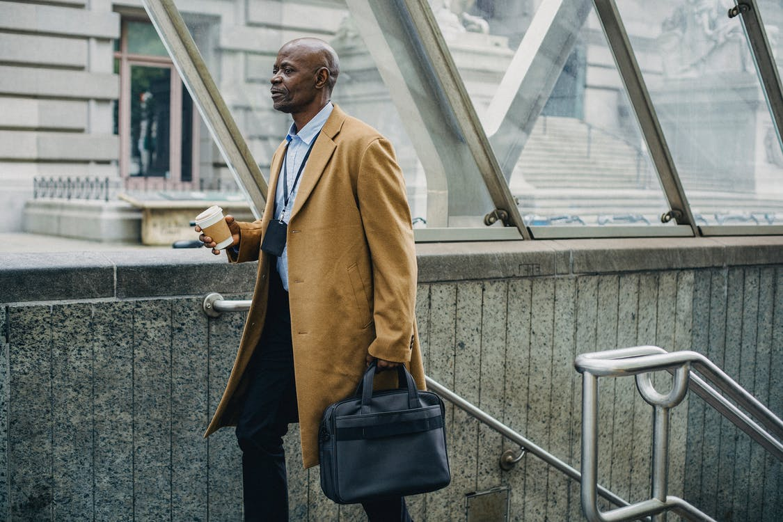 Contemplative black businessman leaving metro station