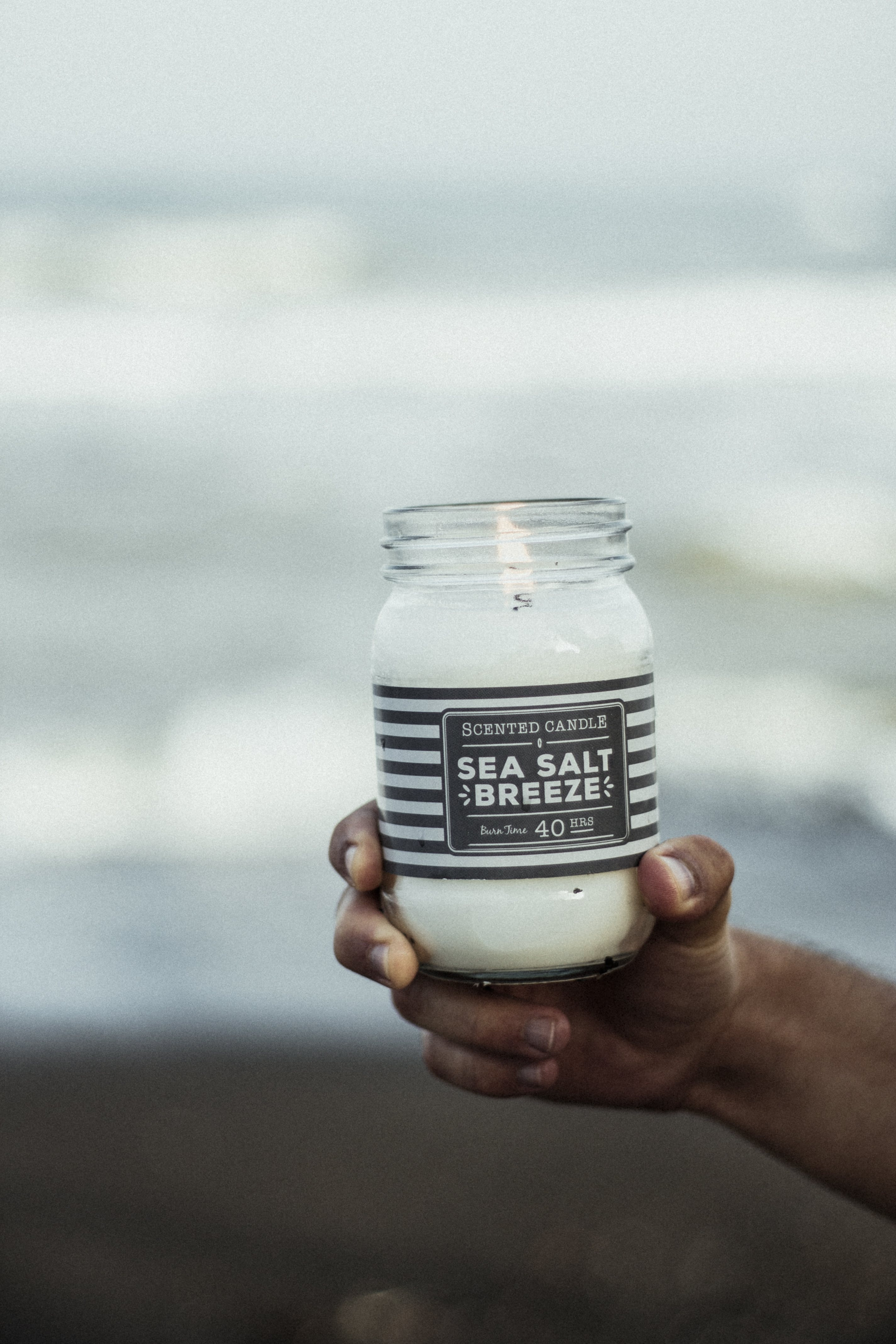 Photo of Hand Holding Sea Salt Breeze Scented Candle