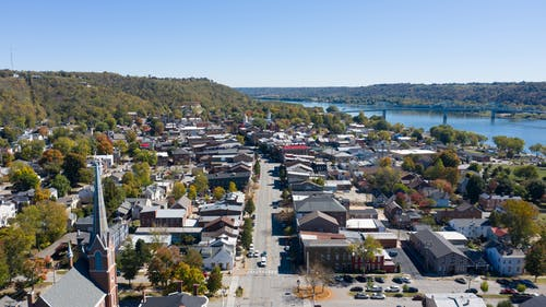 Picturesque view of small coastal town near blue river