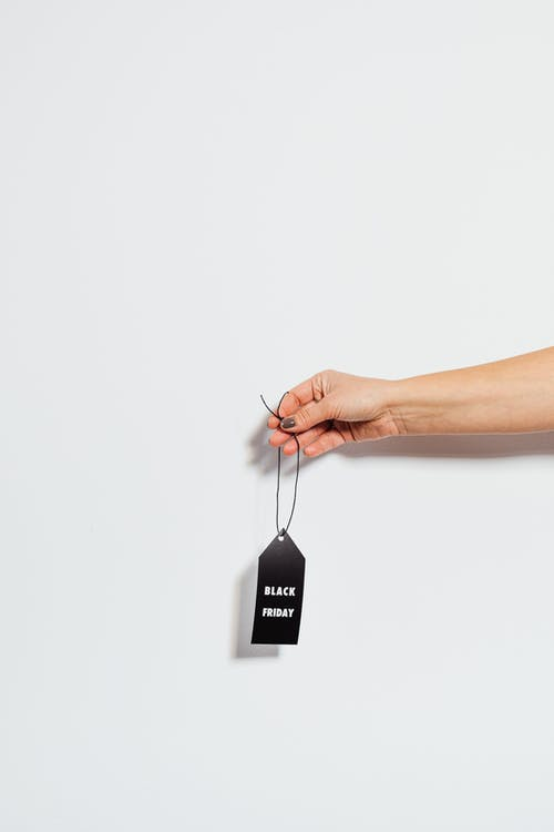 Holding a Black Friday Tag