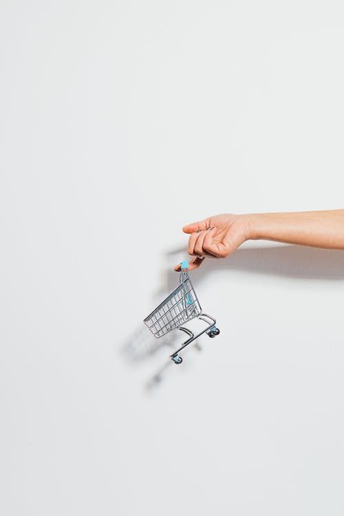 Tiny Shopping Cart Hanging on a Finger