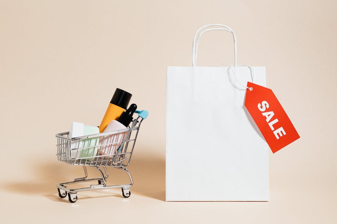 Shopping Cart Next to a Shopping Bag