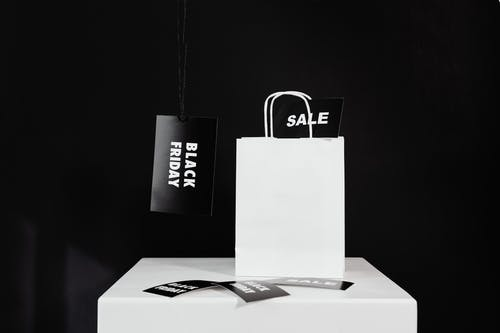Black Friday Tags and a White Paperbag