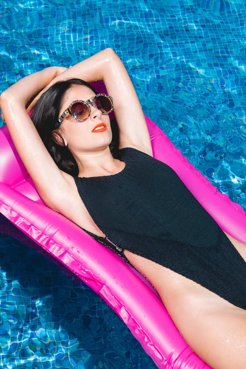 Woman Lying on Pool Float