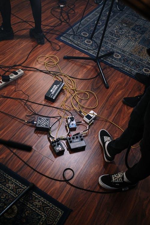 Black Ac Adapter on Brown Wooden Floor