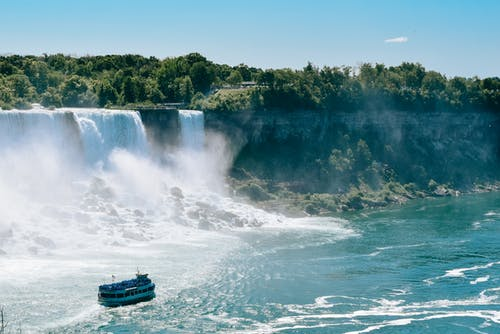 Black Boat on Water Falls
