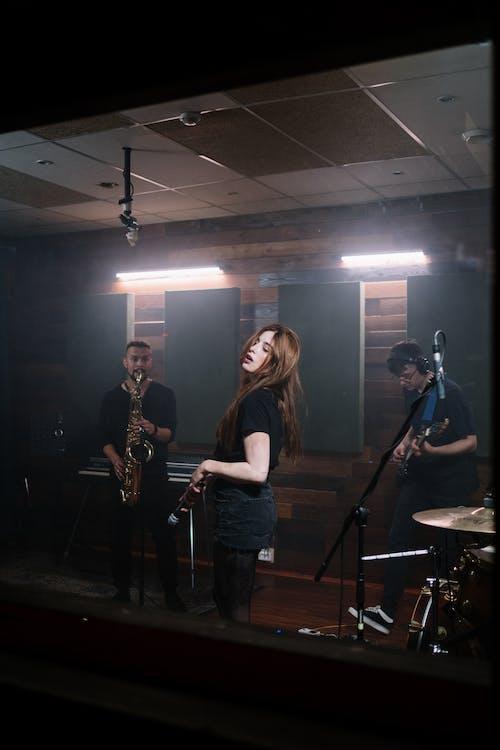 Woman in Black Shirt Playing Saxophone