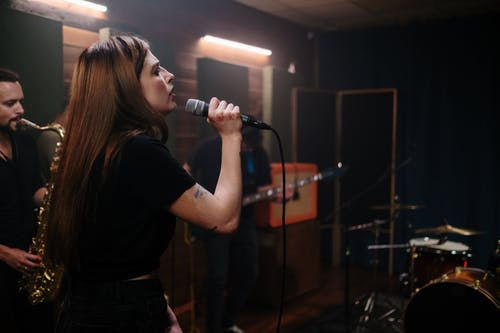 Woman in Black T-shirt Singing