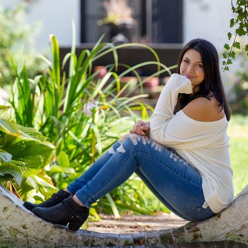 Positive woman sitting on concrete construction