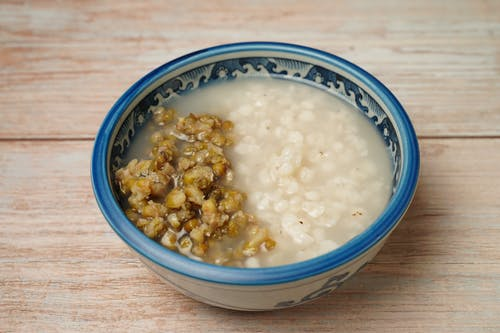 White and Blue Ceramic Bowl With White Soup