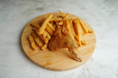 French Fries on Brown Wooden Round Plate
