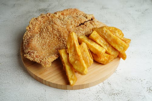 Fried Food on Brown Wooden Round Plate