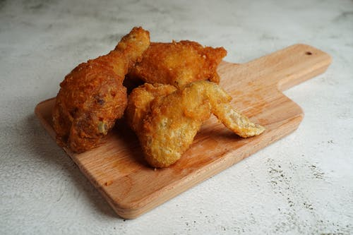 Fried Food on Brown Wooden Chopping Board