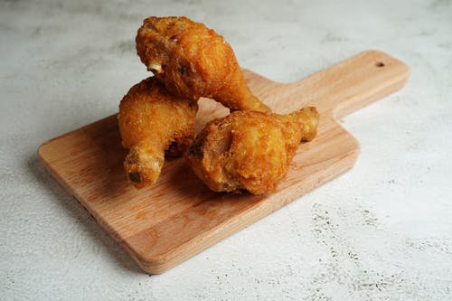 Brown Fried Chicken on Brown Wooden Chopping Board