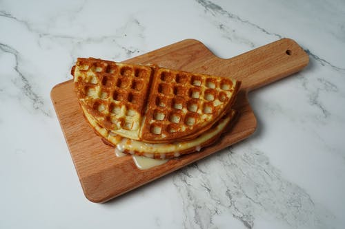 Waffle on Brown Wooden Chopping Board
