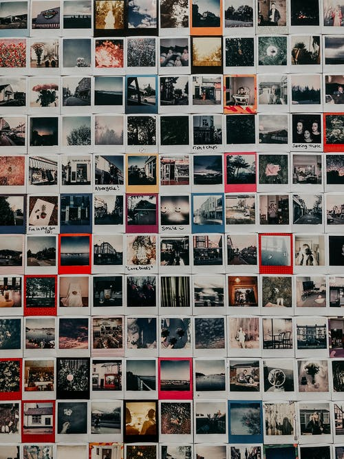 Instant shots with different bright memories of travelling and journeys hanging on wall