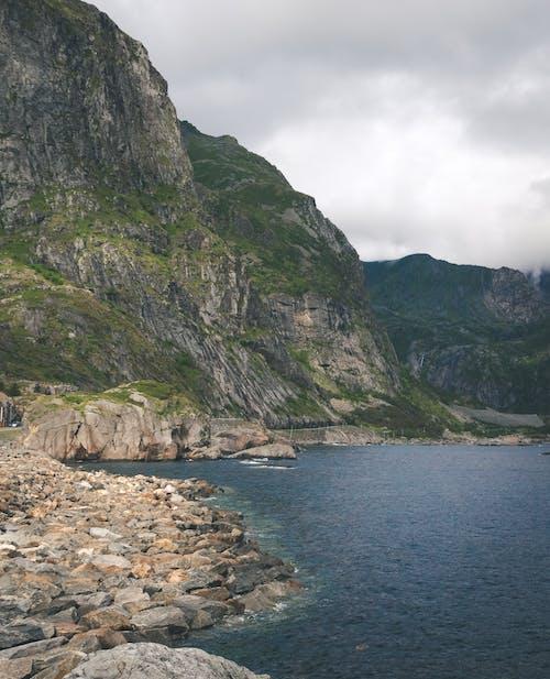 Steep slope of mountain located on coast of lake