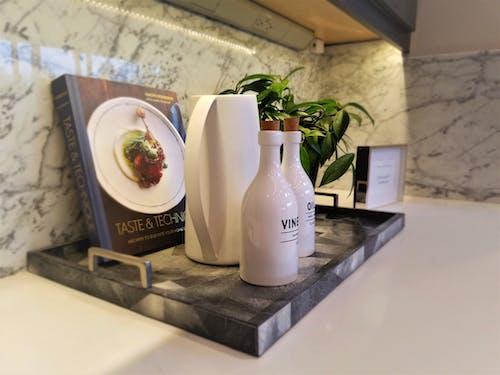 Free stock photo of cookbook, olive oil, vinegar jug