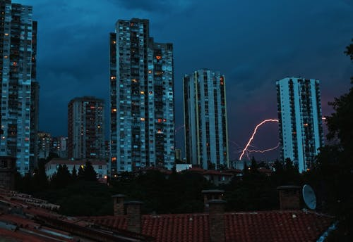 Dark sky above cityscape in storm